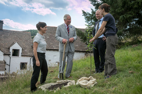 HRH The Prince of Wales plants a rare apple tree during his visit to Llwyn Celyn July 2018